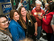 31 OCTOBER 2019 - DES MOINES, IOWA: US Senator AMY KLOBUCHAR (D-MN), blue blazer, takes a selfie with supporters at a restaurant in downtown Des Moines Thursday night during a campaign appearance. Sen. Klobuchar is campaigning to be the Democratic nominee for the US Presidency. Iowa holds the first selection event of the Presidential election cycle. The Iowa caucuses are Feb. 3, 2020.        PHOTO BY JACK KURTZ