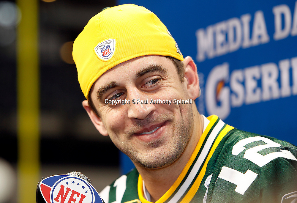 Green Bay Packers quarterback Aaron Rodgers (12) smiles as he speaks to the press at Super Bowl XLV media day prior to NFL Super Bowl XLV against the Pittsburgh Steelers. Media day was held on Tuesday, February 1, 2011 in Arlington, Texas. ©Paul Anthony Spinelli