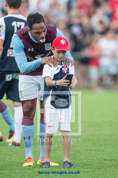 Joleon Lescott of Aston Villa poses for a selfie with a young fan during the pre season friendly match at Sportcentre Weinzoedl, Graz, Austria.<br /> Picture by EXPA Pictures/Focus Images Ltd 07814482222<br /> 09/07/2016<br /> *** UK &amp; IRELAND ONLY ***<br /> EXPA-IES-160709-0026.jpg