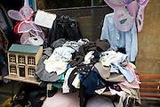 Old clothes and jumble outside charity shop, Walcot, Bath, England