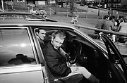 Woodly and Neville, sitting in a car, UK, 1980s.