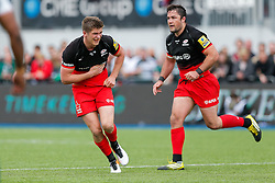 Saracens Fly-Half Owen Farrell looks on in pain after picking up an injury to the side of his body - Mandatory byline: Rogan Thomson/JMP - 21/05/2016 - RUGBY UNION - Allianz Park - London, England - Saracens v leicester Tigers - Aviva Premiership Semi Final.