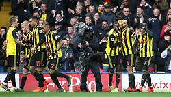 Watford's Troy Deeney (second right) celebrates scoring his side's first goal of the game during the Premier League match at Vicarage Road, Watford.