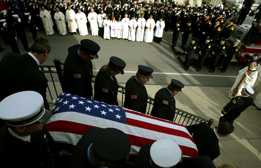 The casket of James Robeson is carried out of St. Patricks Church.  Aimee Dilger Photos/The Times Leader 1/10/2008