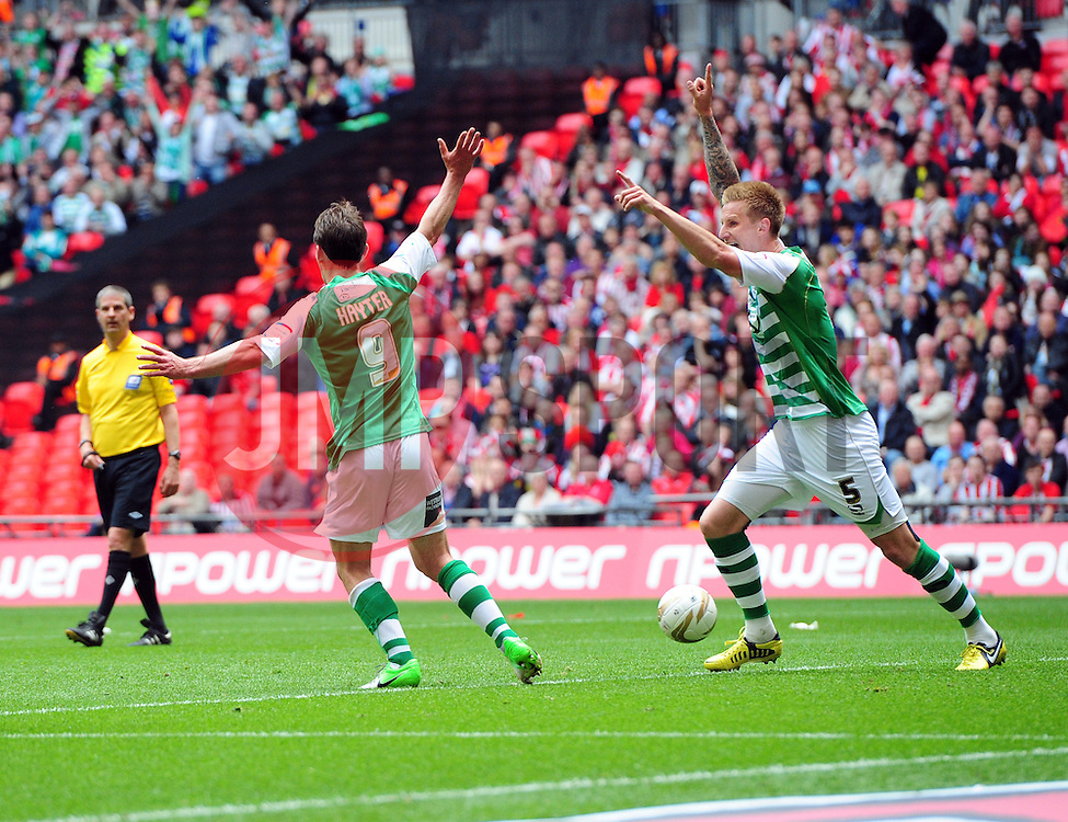 Yeovil Town's James Hayter and Yeovil Town's Byron Webster celebrates Yeovil's second goal of the game - Photo mandatory by-line: Joe Meredith/JMP - Tel: Mobile: 07966 386802 19/05/2013 - SPORT - FOOTBALL - LEAGUE 1 - PLAY OFF - FINAL - Wembley Stadium - London - Brentford V Yeovil Town