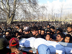 March 22, 2019 - Bandipora, Jammu and Kashmir, India - People carrying shroud clad dead body of  a 10-year-old civilian Aatif Mir S/O Mohd Shafi Mir who was kept hostage by the militants during a gunfight in Mir Mohalla Hajin in North Kashmir's Bandipora district. Aatif who was a lone brother in four sisters and a class 5th students on rolls at Army Goodwill School Hajin was allegedly kept hostage by the militants to hinder the security operation at his uncles house where militants were holed up. SSP Bandipora while briefing media said, '' Militants initially hostage six family members among which five members were rescued but the minor taken hostage by the trapped militants was killed by militants before the teams could reach to the third floor in which they was hiding to rescue the child. (Credit Image: © Raja Faizan Haji/Pacific Press via ZUMA Wire)