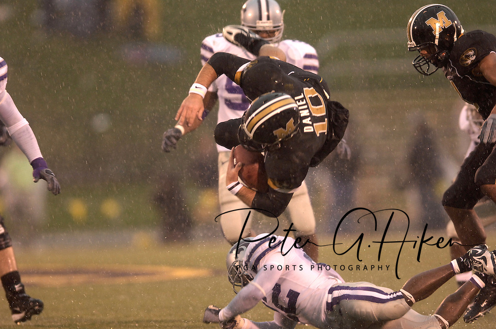 University of Missouri quarterback Chase Daniel (10) is flipped by Kansas State defensive back Justin Mckinney (22) after picking up a first down in the second half at Faurot Field in Columbia, Missouri, October 21, 2006.  The Tigers beat the Wildcats 41-21.<br />