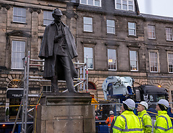 The sculpture of Sherlock Holmes by former pop-artist Gerald Laing is being moved from it's home on Picardy Place, yards from the birth place of Sir Arthur Conan Doyle.<br /> <br /> The move of the sculpture is to accommodate road and tram works that are taking place in Edinburgh. The statue will be moved to Nairn at  Black Isle Bronze Ltd by the artists son, Farquhar Laing where it will stay for two years until it returns to Edinburgh.<br /> <br /> Pictured: Workmen preparing for the lift of the Sherlock Holmes statue
