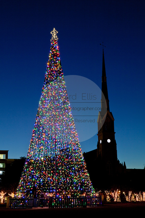 A Christmas Tree decorated with holiday lights frames St Matthews Church on historic Marion Square on December 19, 2011 in Charleston, South Carolina.