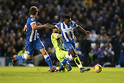 Brighton midfielder, winger, Kazenga LuaLua (30) is fouled resulting in a red card fro Huddersfield Town defender Tommy Smith (2) during the Sky Bet Championship match between Brighton and Hove Albion and Huddersfield Town at the American Express Community Stadium, Brighton and Hove, England on 23 January 2016.