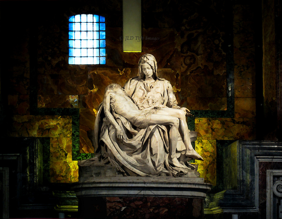 St. Peter's Basilica: Michelangelo's Pieta, behind protective bullet proof glass.  Window on the opposite side of the church is reflected in the glass, creating an ambiguous spacial relationship.