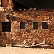 Typical architectural textures in Africa tourism spots.The stone work reminds me of a Giraffe.