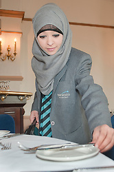 "Hospitality Sheffield's ""Spring Forward"" initiative aimed at attracting the next generation of hospitality professionals took place in Sheffield on Thursday 8th March..Fatima Abdulla of Parkwood Academy tries her had at table laying at the Royal Victorial Holiday Inn ...http://www.pauldaviddrabble.co.uk..3  March 2012 -  Image © Paul David Drabble"