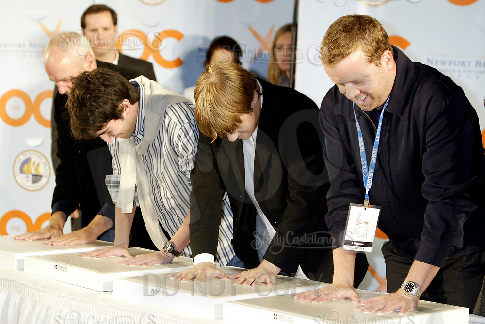 Oct 28, 2004; Newport Beach, CA, USA; Cast & Producers of the FOX hit TV show 'The OC' visited the Balboa Penninsula in Newport Beach to get a Key to the City and be immortalized in cement with thier hand prints to be placed at the enterance to the Historic Balboa Pavillion. (L-R) ALAN DALE, JOSH SCHWARTZ, BENJAMIN MCKENZIE, McG all have thier hands setting in cement.  Mandatory Credit: Photo by Shelly Castellano/ZUMA Press.