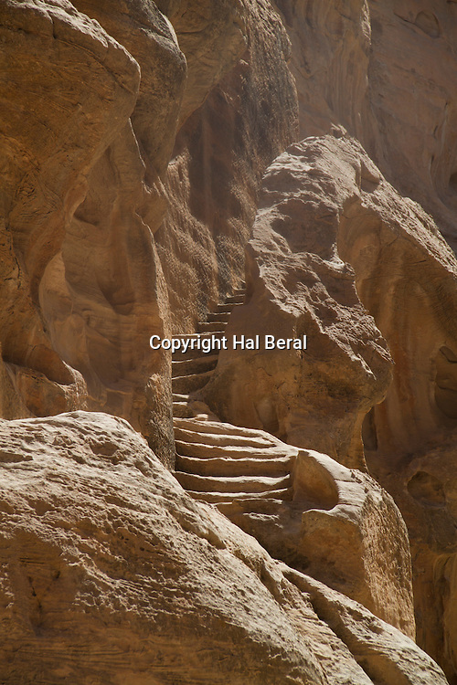Stairs cut into the stone cliff face<br /> Little Petra,Jordan