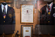 A display for former Grambling State University football head coach Eddie Robinson including his College Hall of Fame certificate and Bobby Dodd Coach of the Year award at the Eddie G. Robinson Museum in Grambling, Louisiana on October 23, 2013.  (Cooper Neill for The New York Times)