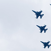 Four military jets fly over Dover International Speedway prior.to the start of the Sprint Cup Series race  Sunday, Oct. 02, 2011 at Dover International Speedway in Dover Delaware.