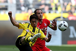 DORTMUND, April 30, 2017  Shinji Kagawa(L) of Borussia Dortmund challenges with Matthias Lehmann of 1.FC Cologne during the Bundesliga soccer match between Borussia Dortmund and 1.FC Cologne at the Signal Iduna Park in Dortmund, Germany on April 29, 2017. The match ended in a 0-0 draw. (Credit Image: © Joachim Bywaletz/Xinhua via ZUMA Wire)