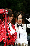 "Costume Play Goth Lolitas. A wide variety of ""costume play"" getups takes in goths, goth lollys, cartoon characters from Japanese manga, anime,  the sweet-and-innocent frilly look or combinations in between. Each and every Sunday these cosplay characters converge on Harajuku Tokyo's fashion district. Most casual observers say that cosplay is a reaction to the rigid rules of Japanese society. But since so many cosplay kids congregate in Harajuku and Aoyama - Tokyo headquarters of Fendi, Hanae Mori and Issey Miyake, others consider it is a reaction to high fashion. Whatever the cause, cosplay aficionados put a tremendous amount of effort into their costumes every Sunday. Though one does wonder what they wear on Monday morning..."