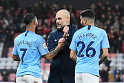 Manchester City manager Pep Guardiola goes to hug Raheem Sterling (7) of Manchester City ignoring goalscorer Riyad Mahrez (26) of Manchester City at full time after a 1-0 win over Bournemouth during the Premier League match between Bournemouth and Manchester City at the Vitality Stadium, Bournemouth, England on 2 March 2019.