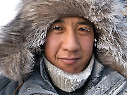 Portrait of person selling frozen fish on the Yakutsk outdoor fish market. Yakutsk is a city in the Russian Far East, located about 4 degrees (450 km) below the Arctic Circle. It is the capital of the Sakha (Yakutia) Republic (formerly the Yakut Autonomous Soviet Socialist Republic), Russia and a major port on the Lena River. Yakutsk is one of the coldest cities on earth, with winter temperatures averaging -40.9 degrees Celsius.