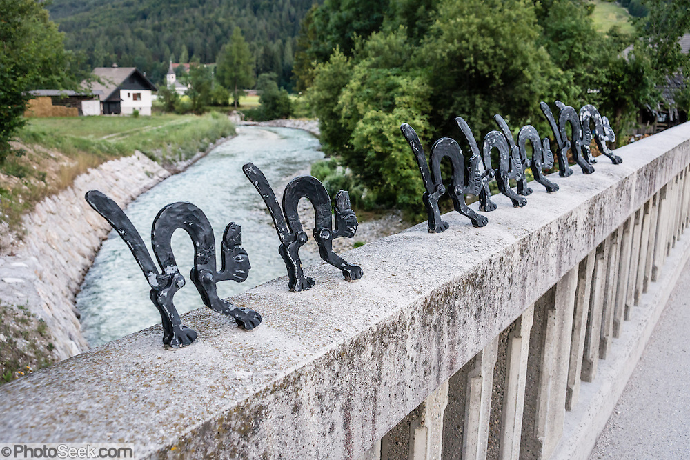 Metal cat sculpture lines bridge rail in Mojstrana, Slovenia, Europe. In 1991, Slovenia declared full sovereignty from Yugoslavia. 80% of its 2 million people speak Slovene. In 2004, Slovenia joined NATO and the EU (European Union), and later adopted the Euro € currency. Slovenia is the richest Slavic nation per capita.