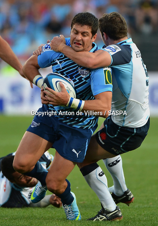 PRETORIA, South Africa, 27 APRIL 2013 : Morne Steyn of the Bulls is stopped by Brendan McKibbin of the Waratahs during the Super Rugby match between the BULLS and the WARATAHS at Loftus Versfeld in Pretoria, South Africa on 27 APRIL 2013. Bulls 30 - 19 Waratahs.<br /> <br /> &copy; Anton de Villiers / SASPA