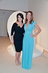 Left to right, MONICA LEWINSKY and HEATHER KERZNER at the Masterpiece Marie Curie Party supported by Jeager-LeCoultre held at the South Grounds of The Royal Hospital Chelsea, London on 30th June 2014.