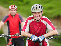 Two cyclists outdoors portrait