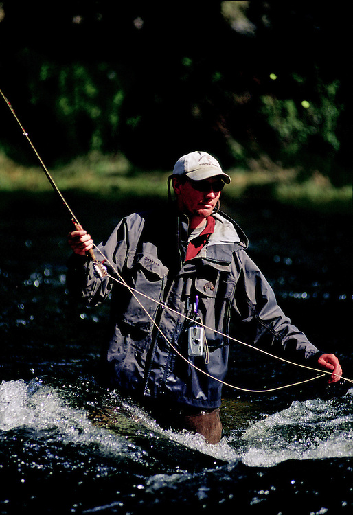 A fly fisherman fishes the Taylor River in the Colorado Rocky Mountains