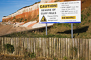Caution beware of cliff falls sign at Hunstanton, Norfolk, England