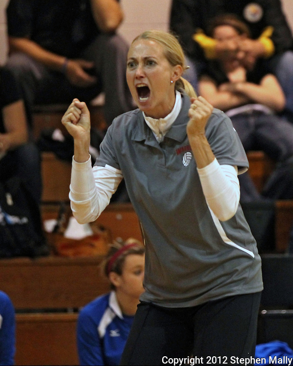Washington head coach Kari Lombardi yells instructions to her team during the MVC Volleyball Tournament semifinal game between the Wahlert Golden Eagles and the Washington Warriors at Kennedy High School in Cedar Rapids on Saturday October 13, 2012. Washington defeated Wahlert 25-13, 25-20.
