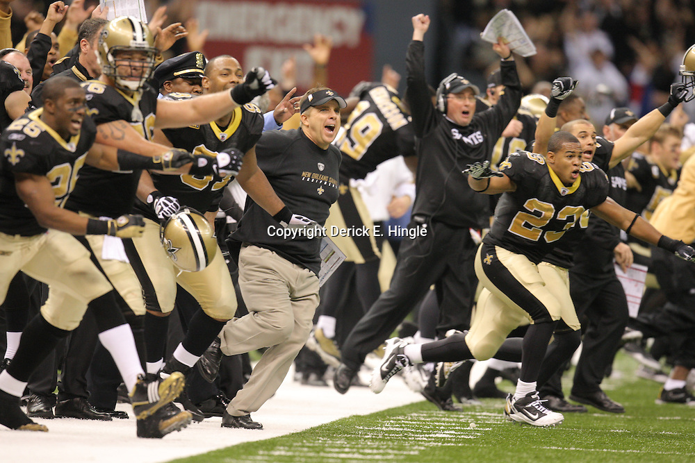 Jan 24, 2010; New Orleans, LA, USA; New Orleans Saints head coach Sean Payton (center) and players rush the field as they advanced to Super Bowl XLVI following a 31-28 overtime victory over the Minnesota Vikings in the 2010 NFC Championship game at the Louisiana Superdome. Mandatory Credit: Derick E. Hingle-US PRESSWIRE