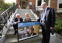Repro Free: 11/10/2013 Jim Sheridan is pictured presenting Liagh Miller, Daffodil Day Emergency Fundraising Committee and John McCormack CEO of the Irish Cancer Society with a signed poster of My Left Foot which will be auctioned in aid of the Irish Cancer Society Masquerade Ball taking place on the 1st November in the Shelbourne Hotel. Tickets can be purchased online at www.cancer.ie/online-shop. Pictures Andres Poveda