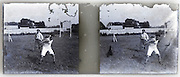 1900s stereo image with discus throwing athlete and trainer