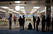 Shoppers line up outside the Apple store in City Creek Shopping Center on Black Friday in Salt Lake City, Friday, Nov. 23, 2012.