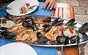 Seafood platter with mussels, shrimps, fish and squid Photographed in Croatia