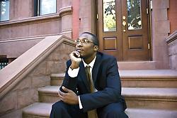 July 21, 2019 - Man Sitting In Front Of Brownstone, Harlem, New York City, New York, Usa (Credit Image: © Aplights/Design Pics via ZUMA Wire)