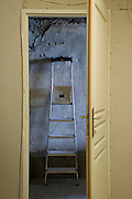 household stepladder against old gray wall