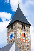 Clock tower of Klosters church in Graubunden region of Switzerland
