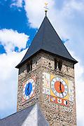 Clock tower of Klosters church in Graubunden region of Switzerland