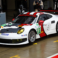 The no.91 Porsche RSR calls into the pits during Friday morning practice, FIA WEC 2013 6h of Silverstone