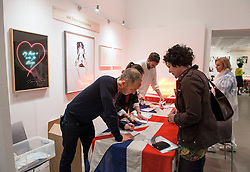 © Licensed to London News Pictures. 05/06/2015. Bristol, UK.  The Other Art Fair comes to the Arnolfini Gallery in Bristol.  Picture of the Tracy Emin stand.  Tracy Emin is one of the group known as Young British Artists from the 1990's.  As the UK's leading artist fair, The Other Art Fair gives art lovers the unique opportunity to buy directly from 70 of the best emerging and undiscovered artists.  Photo credit : Simon Chapman/LNP