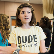 "Ladlie, wearing one of her signature t-shirts that reads, ""Dude, where's my leg?"" reviews homework with her english teacher, Diane Kileen."