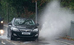 © Licensed to London News Pictures. 01/11/2018. St Mary Cray, UK.Heavy rain making for a wet weather morning in the South East. Water spray from a car on St Mary Cray, High Street. Photo credit: Grant Falvey/LNP