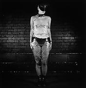 Portrait of Woman in Fetish Bondage Gear and Plastic Wrap