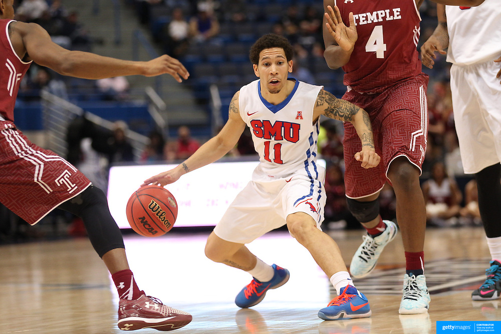 Nic Moore, (left), SMU, is challenged by Daniel Dingle, Temple, during the Temple Vs SMU Semi Final game at the American Athletic Conference Men's College Basketball Championships 2015 at the XL Center, Hartford, Connecticut, USA. 14th March 2015. Photo Tim Clayton