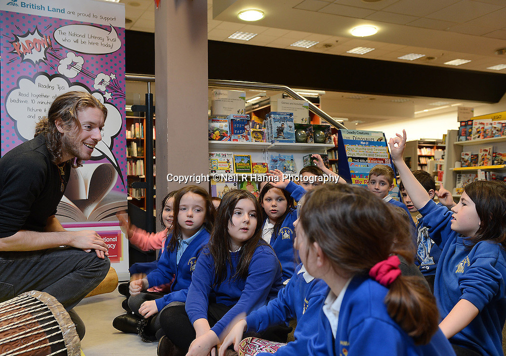 Edinburgh  01/05/2014<br /> Pupils from Brunstane Primary School spent the morning as the guests of British Land at The Fort Kinnaird Shopping Centre and Retail Park.<br /> The pupils were given a tour around the centre which included a Storytelling Session in conjunction with The National Literacy Trust.<br />  Storyteller Daniel Allison entertained the kids with stories in Waterstones Bookshop, in the Centre<br /> Picture © Neil R Hanna