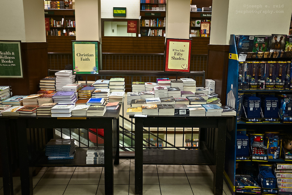 Bookstore display tables, Christian faith books on left, Fifty Shades books on the right, Brooklyn, NY, US