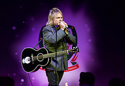 CARDIFF, WALES - Monday, October 5, 2015: Mike Peters of the Alarm performs during the FAW Awards Dinner at Cardiff City Hall. (Pic by Ian Cook/Propaganda)